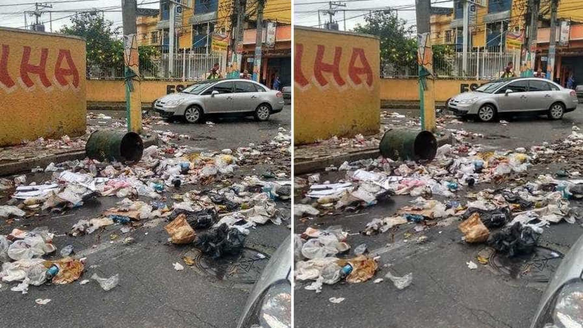 Garis espalham lixo pelas ruas em protesto por falta de pagamento
