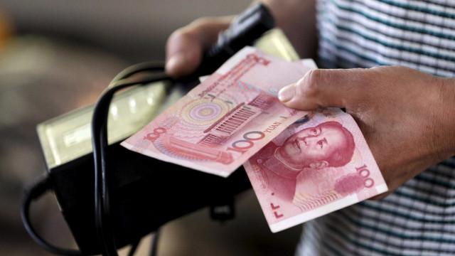 Bancos chineses fazem venda líquida de 221,27 bilhões de yuans
