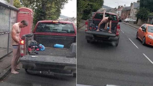 Homem nu realiza o desafio das 22 flexões em uma pick-up