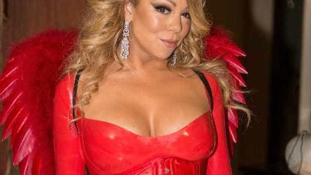 Com os filhos, Mariah Carey causa de diabinha e super decote