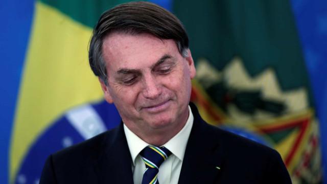 Mulher pede reabertura do comércio e recebe apoio de Bolsonaro