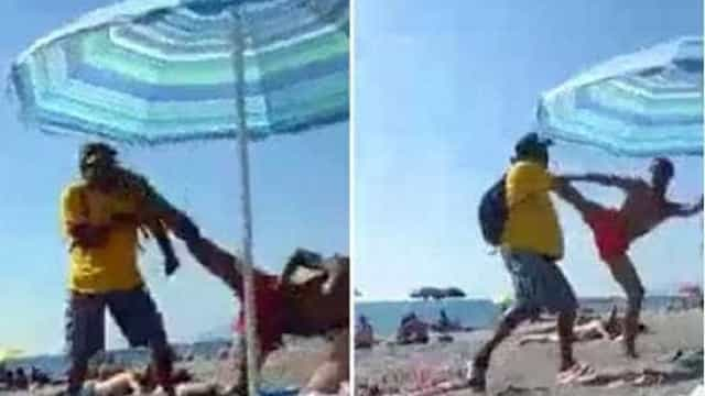 Banhista italiano chuta ambulante imigrante no rosto; assista!