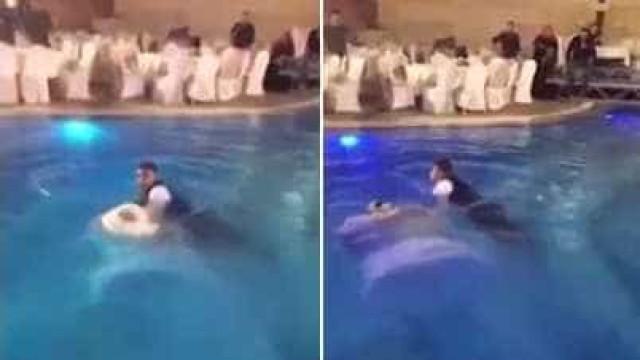 Mulher vestida de noiva quase se afoga ao pular em piscina; assista!