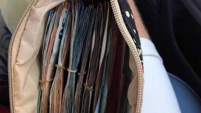 Casal acha mais de R$ 30 mil na Grécia e devolve dinheiro à dona