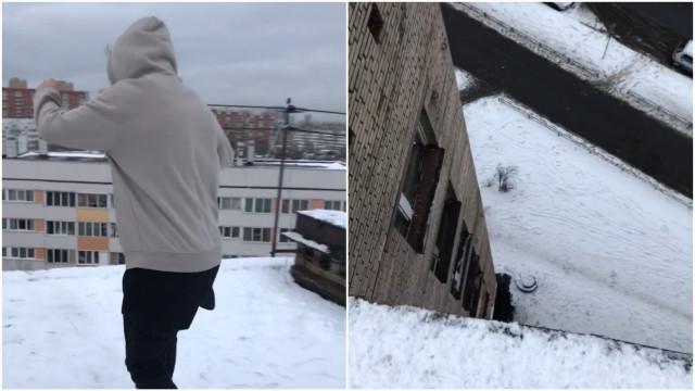 Jovem desliza sobre gelo no alto de um prédio